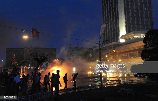 Fireworks explode on a water cannon as Turkish police battle antigovernment protestors to reestablish police control of Taksim Square after an...