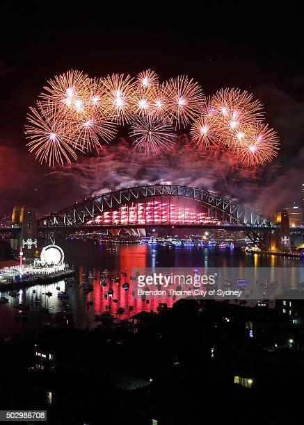 Fireworks explode on New Year's Eve on Sydney Harbour on January 1 2016 in Sydney Australia