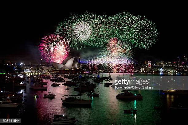 Fireworks explode on the Sydney Harbour Bridge on New Year's Eve on Sydney Harbour on January 1 2016 in Sydney Australia