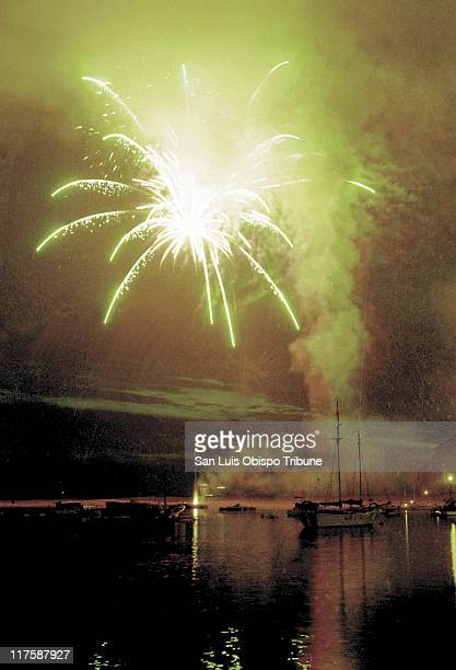 Fireworks explode over barges at Tidelands park in Morro Bay California July 4 2001 Watch out marine mammals Here come the California coastal...