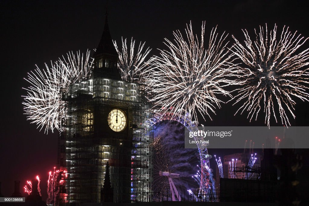 Fireworks explode over Big Ben and the giant Ferris wheel of the London Eye at midnight as thousands gather to ring in the near year on January 1, 2018 in London, England. Crowds lined the banks of the River Thames in central London to see in 2018 with a spectacular fireworks display. After being silenced for renovation work, Big Ben's famous bongs rang out over the Christmas period and are ushering in at midnight the new year, falling silent once again on New Year's Day at 1 pm, to continue ongoing crucial repairs of the Elizabeth Tower.