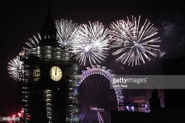 Fireworks explode over Big Ben as thousands gather to ring in the near year on January 1 2018 in London England Crowds lined the banks of the River...