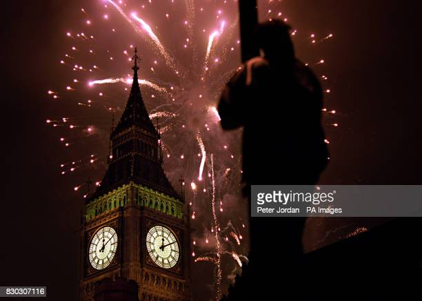 Fireworks explode over Big Ben at the stroke of midnight in London to usher in the new Millennium in the United Kingdom