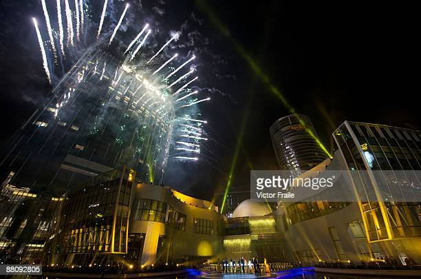 Fireworks explode over businessman James Packer and CEO of Melco Entertainment Lawrence Ho's 'City of Dreams' casino on June 1 2009 in Cotai Macau...