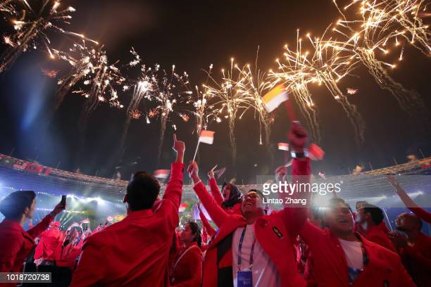 Fireworks explode over Gelora Bung Karno Main Stadium during the opening ceremony of the Asian Games on August 18 2018 in Jakarta Indonesia