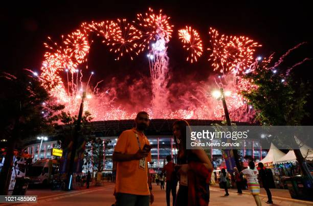 Fireworks explode over Gelora Bung Karno Main Stadium during the opening ceremony of the 18th Asian Games on August 18 2018 in Jakarta Indonesia
