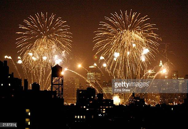 Fireworks explode over Manhattan during the Macy's Fourth of July fireworks July 4 2003 In New York City