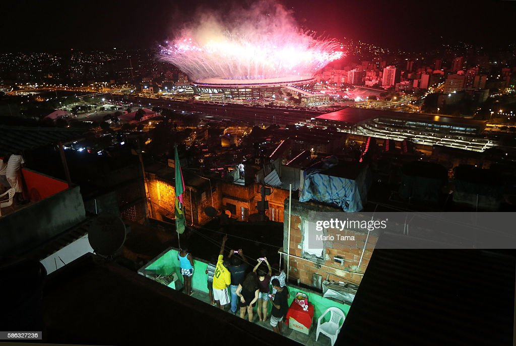Fireworks explode over Maracana stadium with the Mangueira 'favela' community in the foreground during opening ceremonies for the Rio 2016 Olympic Games on August 5, 2016 in Rio de Janeiro, Brazil. The Rio 2016 Olympic Games commenced tonight at the iconic stadium.