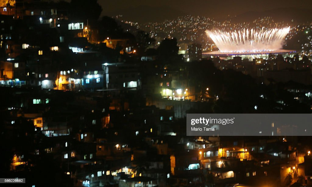 Fireworks explode over Maracana stadium with the Prazeres 'favela' community (L) in the foreground during opening ceremonies for the Rio 2016 Olympic Games on August 5, 2016 in Rio de Janeiro, Brazil. The Rio 2016 Olympic Games commence tonight at the iconic stadium.