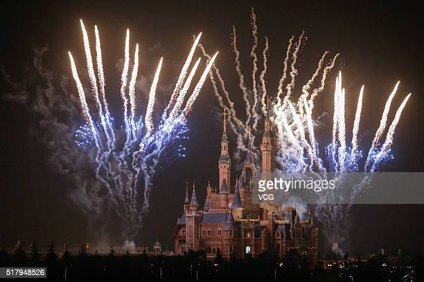 Fireworks explode over Shanghai Disneyland park on March 28 2016 in Shanghai China Shanghai Disneyland tested to set off the fireworks for the first...