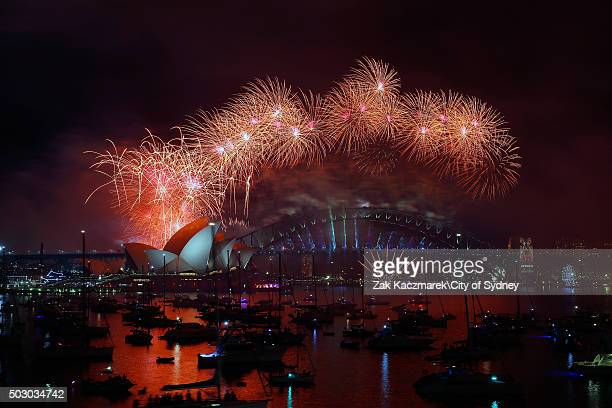 Fireworks explode over Sydney harbour Bridge and the Sydney Opera House on New Year's Eve on Sydney Harbour on January 1 2016 in Sydney Australia