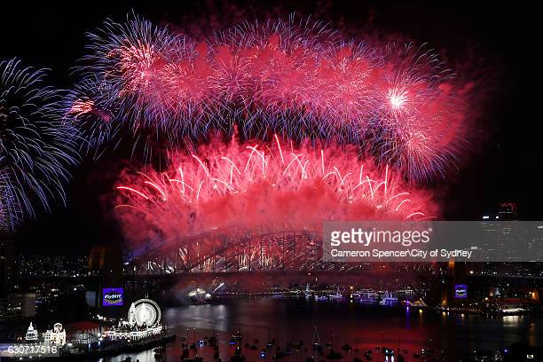 Fireworks explode over Sydney Harbour Bridge on New Year's Eve on Sydney Harbour on January 1 2017 in Sydney Australia