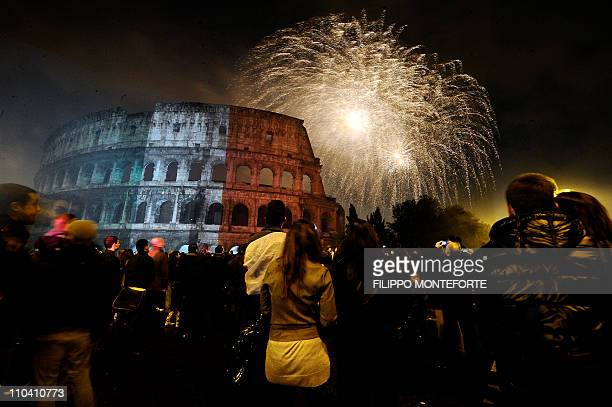Fireworks explode over the ancient Colosseum as part of the celebrations of Italy's 150year anniversary as a unified state in central Rome on March...