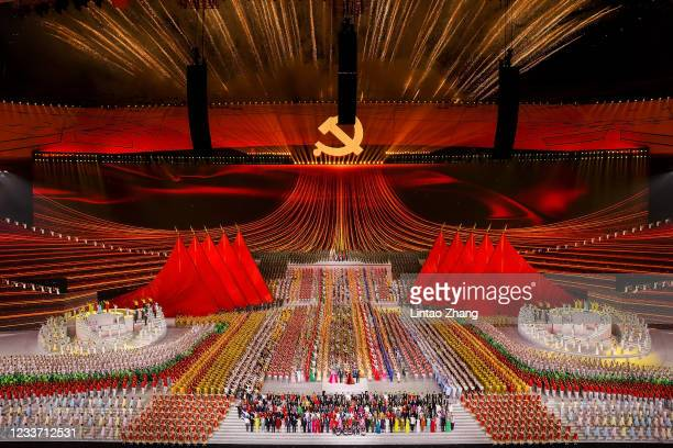 Fireworks explode over the Birds Nest stadium during the art performance celebrating the 100th anniversary of the Founding of the Communist Party of...