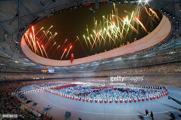 Fireworks explode over the Bird's Nest stadium during the opening ceremony of the 2008 Beijing Olympics in Beijing, China, on Friday, Aug. 8, 2008....