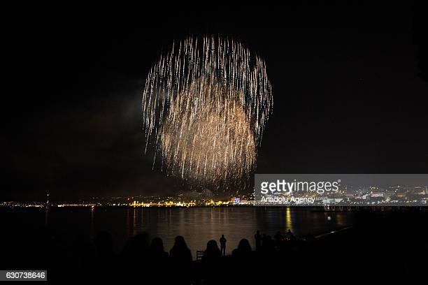 Fireworks explode over the Cannes Bay 'Croisette' during the New Year celebrations as the famous known city mark the 70th anniversary of the...