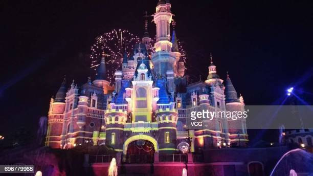 Fireworks explode over the castle at an event to mark the first anniversary of the opening of Shanghai Disneyland on June 16 2017 in Shanghai China
