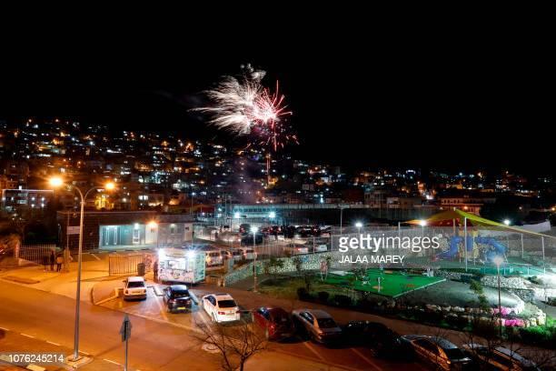 Fireworks explode over the Druze city of Majdal Shams in the Israeliannexed Golan Heights facing the Syrian border on January 1 2019