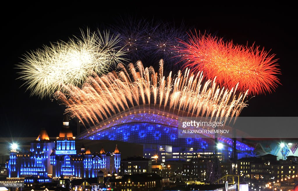 Fireworks explode over the Fisht Olympic Stadium at the begining of the Opening Ceremony of the Sochi Winter Olympics on February 7, 2014 in Sochi.