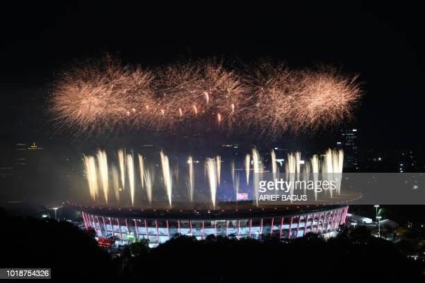 TOPSHOT Fireworks explode over the Gelora Bung Karno main stadium during the opening ceremony of the 2018 Asian Games in Jakarta on August 18 2018