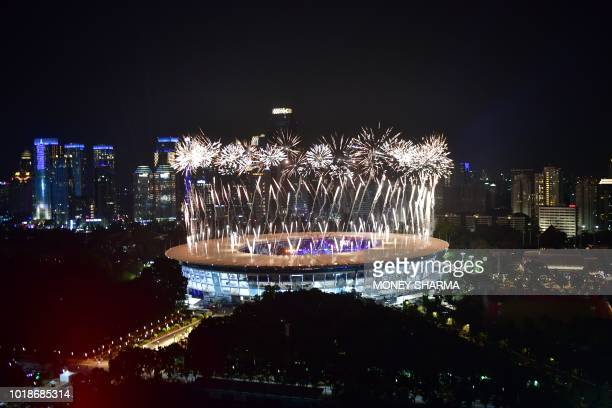 TOPSHOT Fireworks explode over the Gelora Bung Karno main stadium durinh the opening ceremony of the 2018 Asian Games in Jakarta on August 18 2018