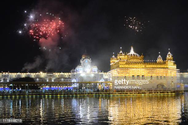 Fireworks explode over the Golden Temple as Indian Sikh celebrate andi Chhor Divas or Diwali in Amritsar on October 27 2019 Sikhs celebrate Bandi...