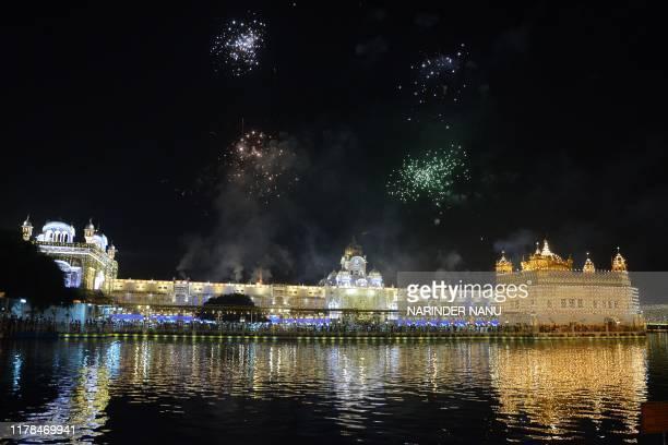 TOPSHOT Fireworks explode over the Golden Temple as Indian Sikh celebrate andi Chhor Divas or Diwali in Amritsar on October 27 2019 Sikhs celebrate...