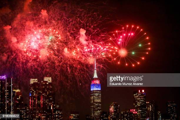 Fireworks explode over the Hudson River against the backdrop of the Empire State Building marking Chinese New Year celebrations on February 14 2018...