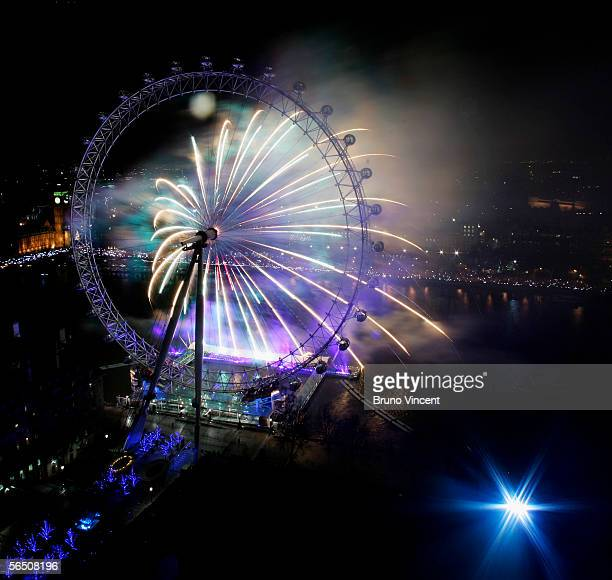 Fireworks explode over the London Eye a Westminster landmark at the stroke of midnight January 1 2006 in London Revelers gathered in the city's...