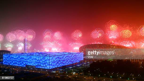 Fireworks explode over the National and swimming Stadia during a rehearsal for the opening ceremony of the 2008 Beijing Olympic Games on July 16 2008...