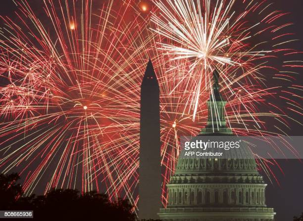 TOPSHOT Fireworks explode over the National Mall as the US Capitol and National Monument are seen on July 4 in Washington DC / AFP PHOTO / PAUL J...