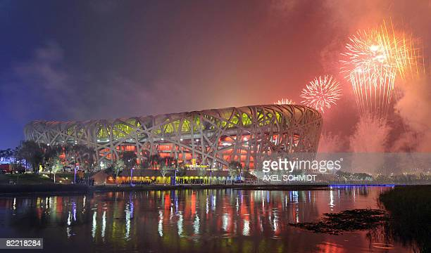 Fireworks explode over the National Stadium also known as the 'Bird's Nest' during the opening ceremony of the 2008 Beijing Olympic Games on August 8...