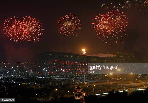 Fireworks explode over the National Stadium, better know as Bird's Nest, as the torch is lit during the opening ceremony of the 2008 Beijing Olympic...