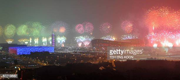 Fireworks explode over the National Stadium better know as the Bird's Nest and the National Aquatics Center during the opening ceremony of the 2008...