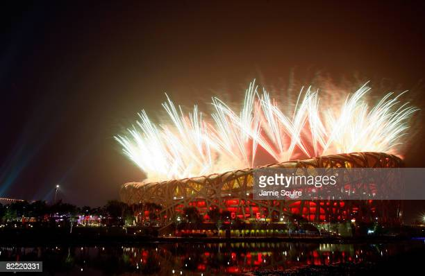 Fireworks explode over the National Stadium during the Opening Ceremony for the 2008 Beijing Summer Olympics at the Great Wall on August 8 2008 in...