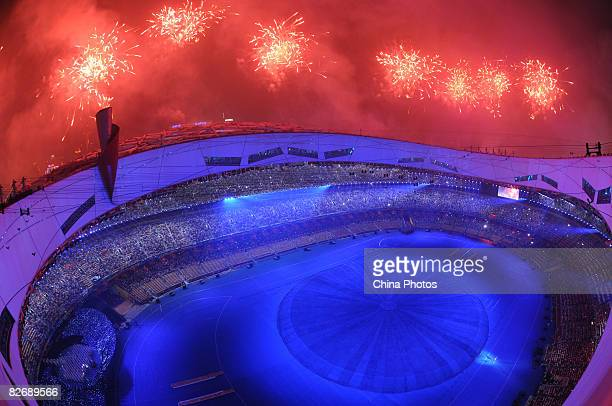 Fireworks explode over the National Stadium during the Opening Ceremony of the Beijing 2008 Paralympic Games on September 6 2008 in Beijing China