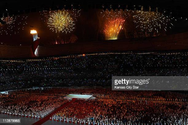 Fireworks explode over the National Stadium during the opening ceremony on Friday August 8 to kick off the Games of the XXIX Olympiad in Beijing China