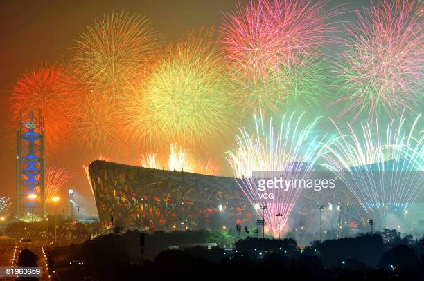Fireworks explode over the National Stadium, known as Bird's Nest, during a rehearsal for the opening ceremony of the 2008 Beijing Olympic Games on...