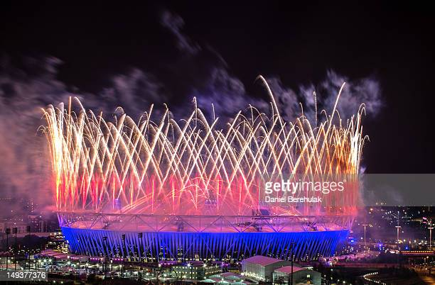 Fireworks explode over the Olympic Stadium during the opening ceremony of the 2012 London Olympic Games on July 27 2012 in London England Athletes...