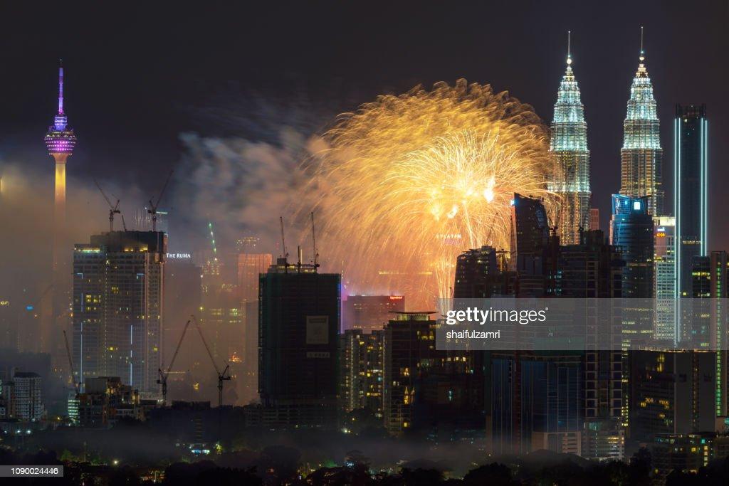 Fireworks explode over the Petronas Twin Towers in Kuala Lumpur, Malaysia. : Stock Photo