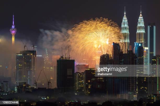 Fireworks explode over the Petronas Twin Towers in Kuala Lumpur, Malaysia.