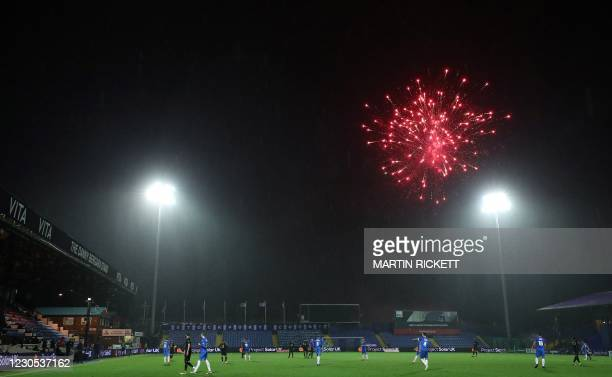 Fireworks explode over the pitch, stopping play, during the English FA Cup third round football match between Stockport County and West Ham United at...