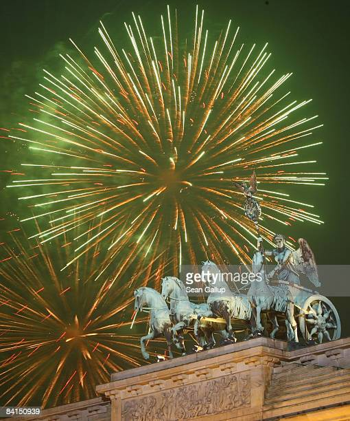 Fireworks explode over the Quadriga sculpture on the Brandenburg Gate in celebration of the new year on January 1 2009 in Berlin Germany An estimated...