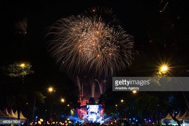 Fireworks explode over the Reforma Avenue during the New Year's Eve celebrations on December 31 2014 in Mexico City Mexico
