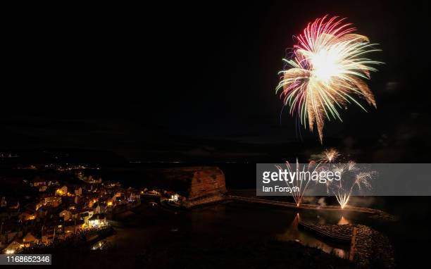 Fireworks explode over the small fishing village of Staithes during celebrations for the Staithes Lifeboat Weekend on August 17 2019 in Staithes...