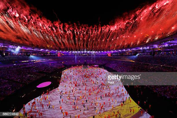 Fireworks explode over the stadium during the Opening Ceremony of the Rio 2016 Olympic Games at Maracana Stadium on August 5, 2016 in Rio de Janeiro,...