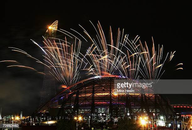 Fireworks explode over the stadium during the opening ceremony of the 15th Asian Games Doha 2006 at the Khalifa Stadium, December 1, 2006 in Doha,...