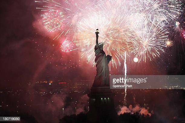 Fireworks explode over the Statue of Liberty in celebration of the anniversary of its dedication on October 28 2011 in New York City The celebrations...
