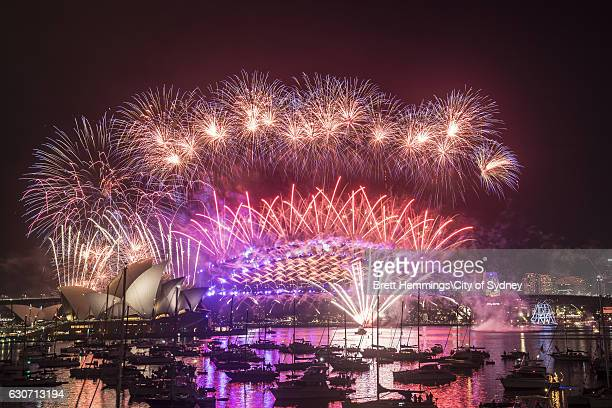 Fireworks explode over the Sydney Harbour Bridge and the Sydney Opera House on New Year's Eve on Sydney Harbour on January 1 2017 in Sydney Australia