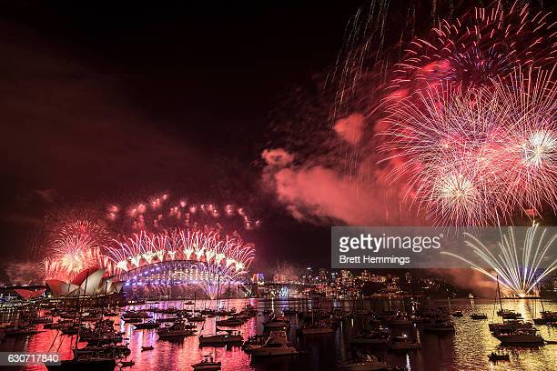Fireworks explode over the Sydney Harbour Bridge and the Sydney Opera House on New Year's Eve on January 1 2017 in Sydney Australia